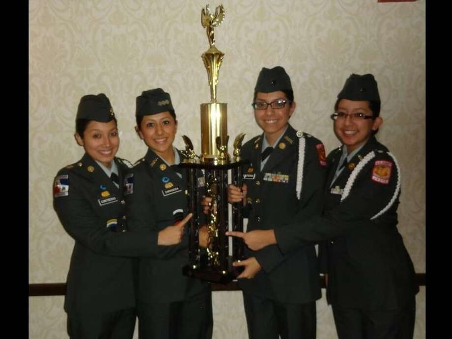 Members of the Texan Pride Unarmed Color Guard consisted of Team Captain Miriam Zaragoza and team members First Sergeant Jessica Contreras and Lieutenants Julie Centeno and Alma Contreras. Photo: SUBMITTED PHOTO