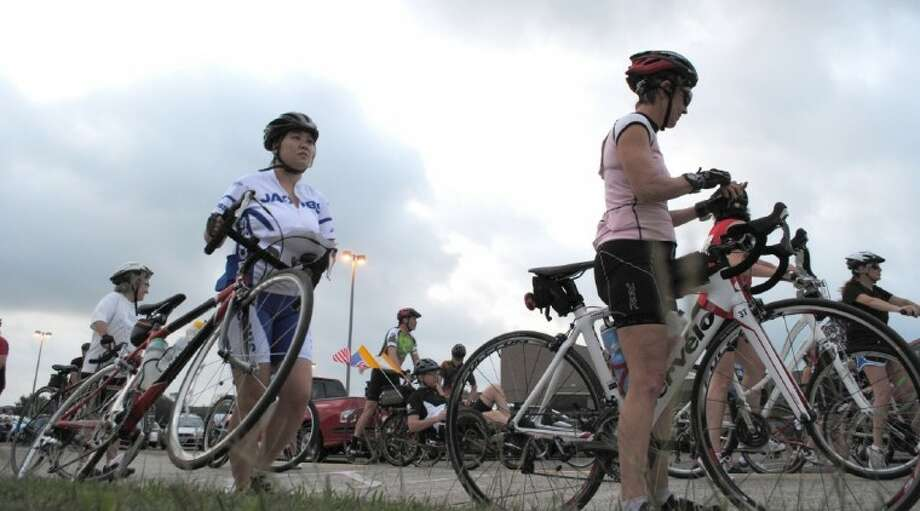 Riders prepare their mark to start their route during the 19th Annual Tour De Braz on April 15. The event benefits the Animal League of Alvin and Friends of Alvin Parks Foundation. Photo: ACC