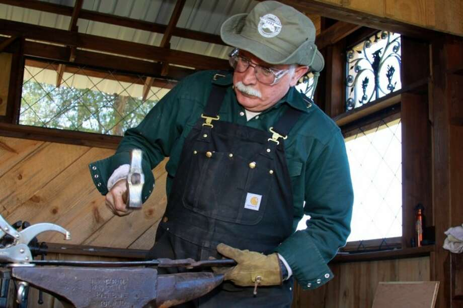 The Houston Area Blacksmith Association's Richard Boswell works on metal tools at Depot Day on April 22 at The Depot in Magnolia.