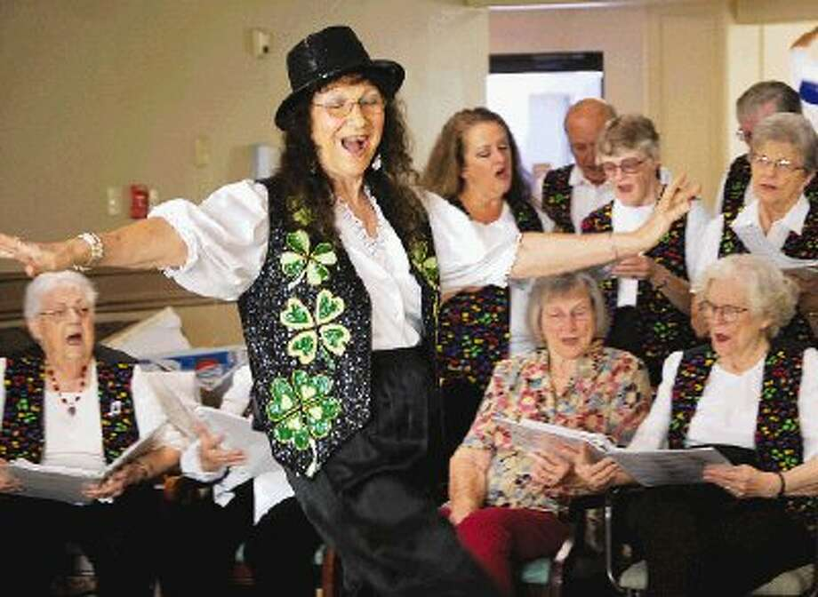 Jane Pratka, an RSVP volunteer from Crosby, and the May Bells and Bows transport residents of the Oak Manor nursing home in Humble back to the past with singing and dancing.