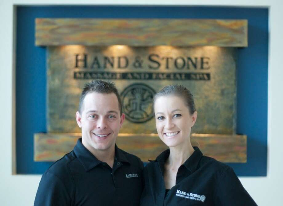 Tony and Brittany Rodgers are the owners of Hand & Stone Massage and Facial Spa at 4526 Research Forest Drive in The Woodlands. Photo: Staff Photo By Eric S. Swist