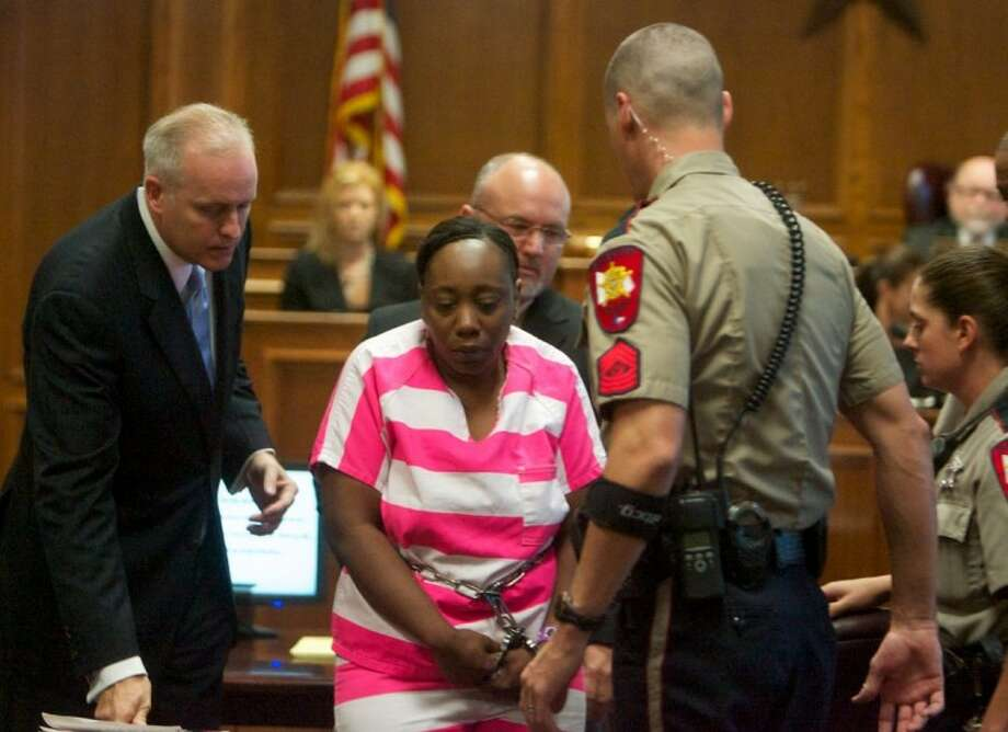 Verna McClain, center, is escorted from the courtroom after a hearing Thursday at the Montgomery County Courthouse in Conroe. McClain is charged with capital murder in the shooting death of Kala Golden and the kidnapping of Golden's 3-day-old son, Keegan Schuchardt. Investigators say McClain waited outside a pediatrician's office near The Woodlands and shot Golden before taking her newborn son. Photo: Staff Photo By Eric S. Swist