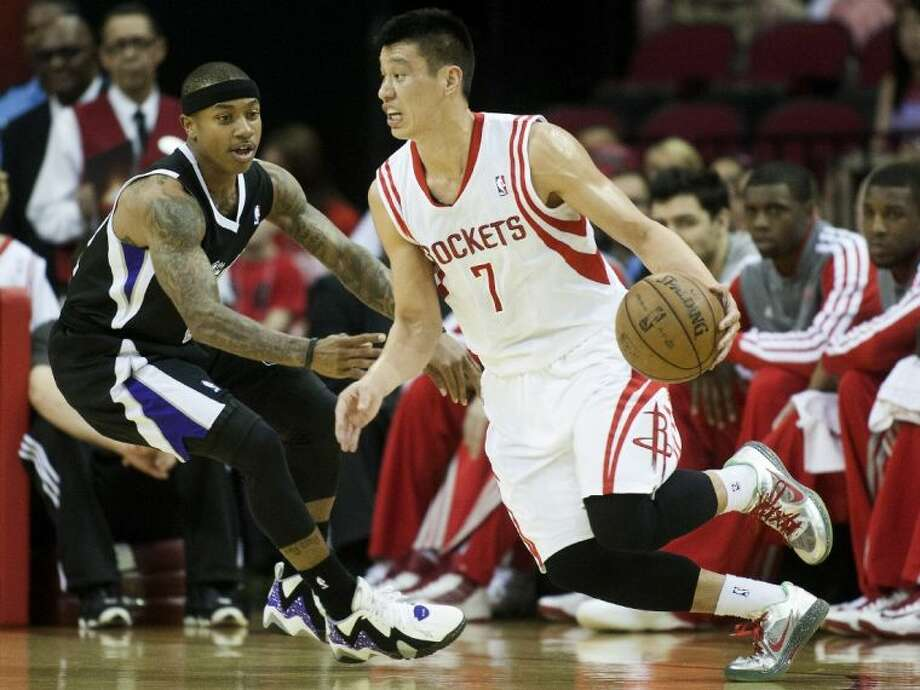 Rockets guard Jeremy Lin, right, drives against the Kings' Isaiah Thomas. The Rockets won 121-100.