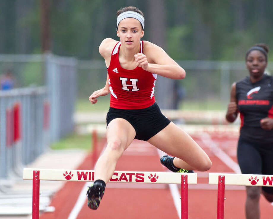 Shelby Russell competes in the 300-meter hurdles during the District 22-3A Track and Field Championships held April 11, 2013, at Splendora High School. Photo: Photo By Amanda J.Cain