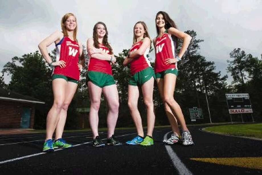 Alana Brady, Michelle Creasman, Madi McLellan and Katie Willard make up The Woodlands High School 4x800-meter relay team, which has posted the nation's top time so far this season. Photo: Karl Anderson