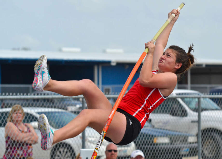 Porter's Meagan Rodriguez competes in the pole vault at the District 19-4A Track and Field Championships held April 8, 2013, at Eagle Stadium in Mont Belvieu.  Photo: Photo By Stephen Whitfield