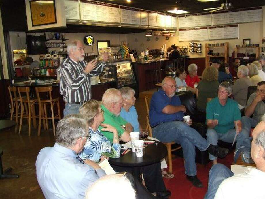 Rusty Cates (standing in striped shirt) talks to members of newly forming Coffee Party.