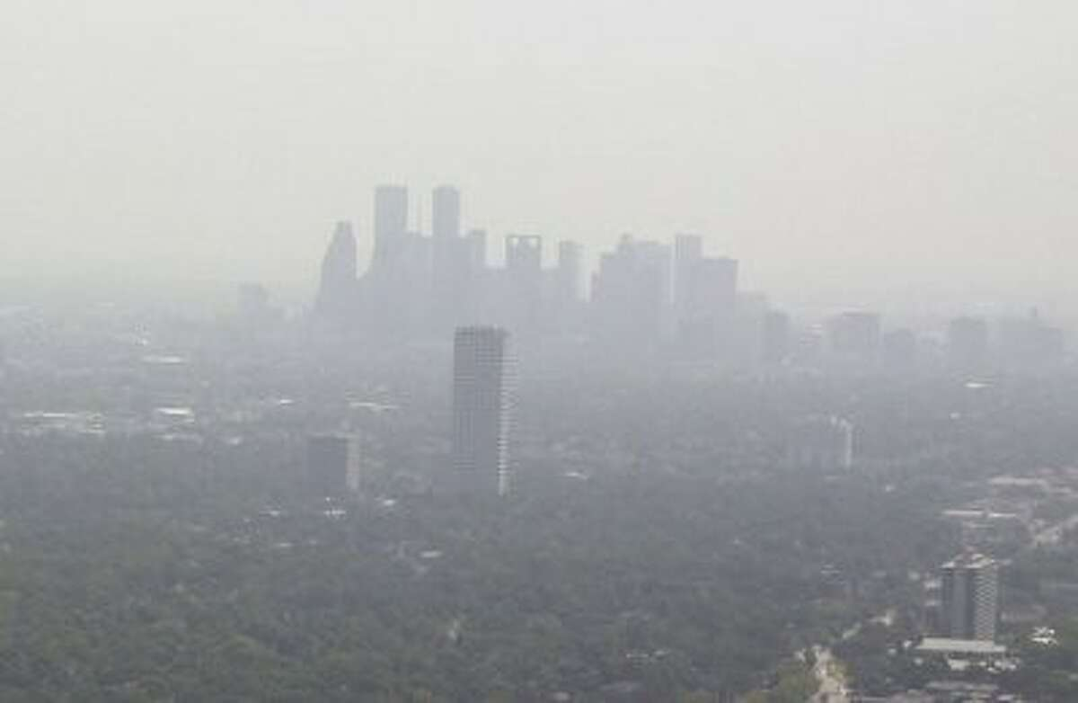 Photo by NOAAThe murky Houston skyline. A report from the American Lung Association says steady improvement is being made against air pollution, but that levels are still dangerous.