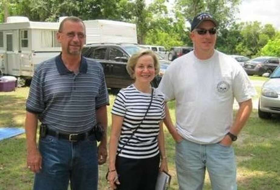Tom Branch, director of the Office of Emergency Management for Liberty County, Cleveland Mayor Jill Kirkonis and Cleveland Fire Chief and EMS Director Steve Rasberry were among the guests for the Sam Houston Amateur Radio Klub's gathering for national field day for ham radio operators last year. Photo: Submitted Photo