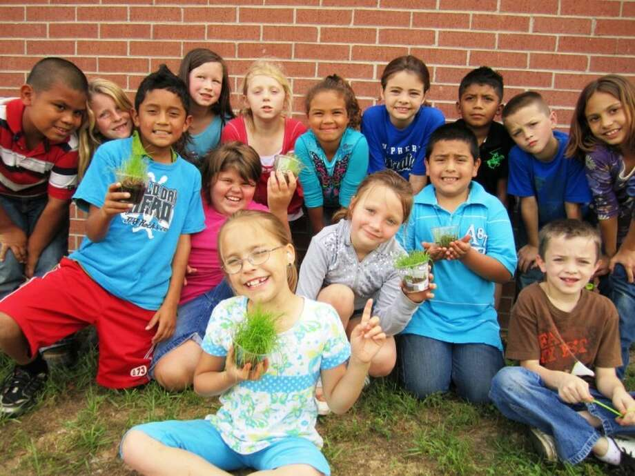 "Shepherd Primary second grade students had fun taking home grass seeds for the ""Happiest Grass"" plant competition. Photo: Submitted Photo"