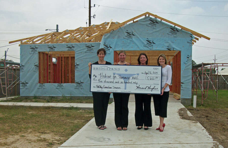 This week, Bridgeland donated $5,600 to Habitat for Humanity Northwest Harris County (NWHC), the culmination of last year's Holiday Countdown promotion. Shown here at a Habitat house under construction in Hamill Crossing are, from left, Cindy Theut with Bridgeland, Karly Grilliot, Habitat for Humanity NWHC development manager, and Lona Shipp and Martha Gros, both with Bridgeland.