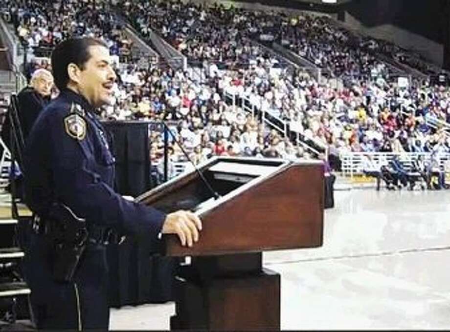 Harris County Sheriff Adrian Garcia addresses new U.S. citizens in a naturalization ceremony.