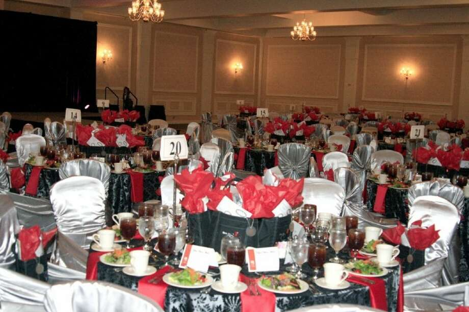 The grand ballroom at the Houston Airport Marriott was decorated by volunteers with red decor last year in honor of the theme for the annual Go Red for Women Luncheon. This year's luncheon will be May 4. Photo: JENNIFER SUMMER