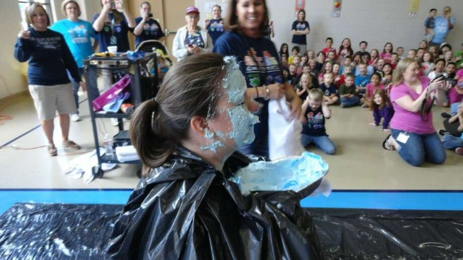 Ben Bowen Early Childhood Center Assistant Principal Mrs. Cordova takes three blue pies in the face April 13 to raise funds for autism awareness. The occasion was a PTA fundraiser. Photo: SUBMITTED PHOTO