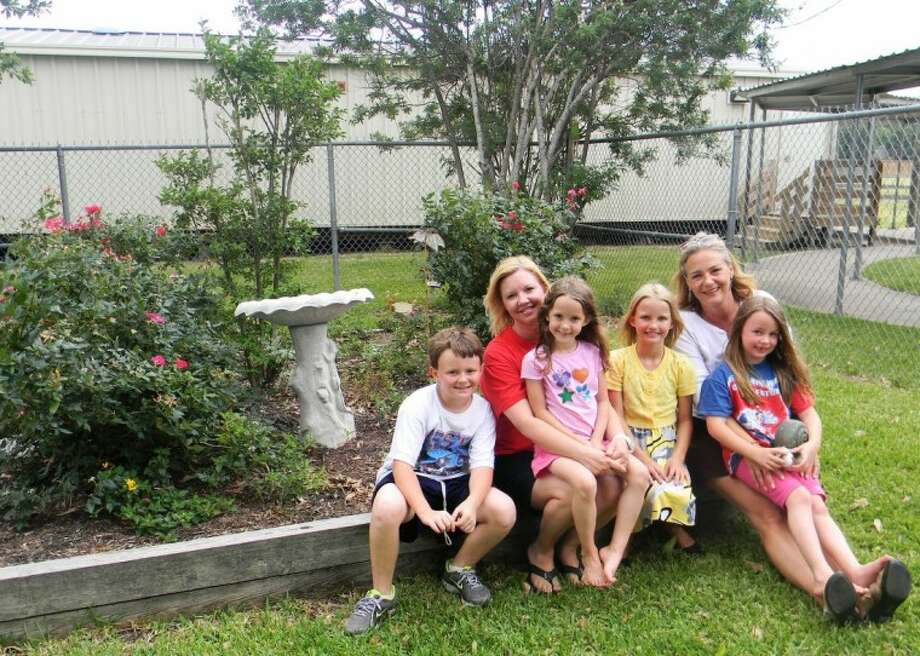 Inside the nature and science garden are PTO co-presidents Kim Ratliff and Julie Conroy with their children, from left, Sean Conroy, Lexi and Taylor Ratliff, and Sarah Conroy.