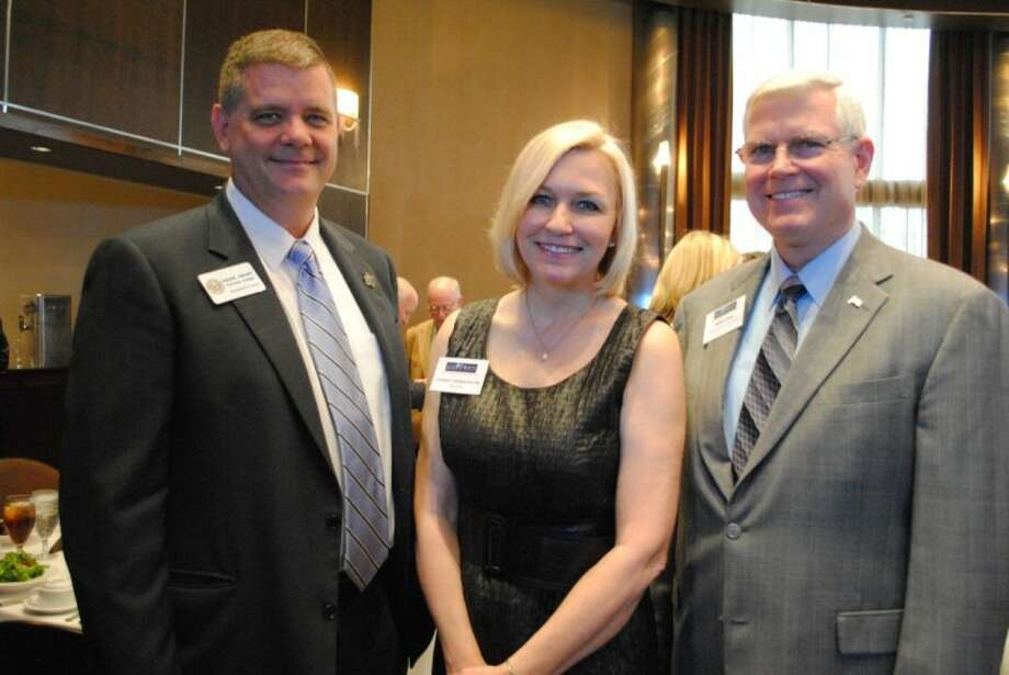 BayTran President Coletta Castleshouldt welcomes Galveston County Judge Mark Henry, left, and Johnson Space Center Director Mike Coats to BayTran's monthly luncheon at Cullen's, which featured Coats as the keynote speaker. Photo: Mary Alys Cherry