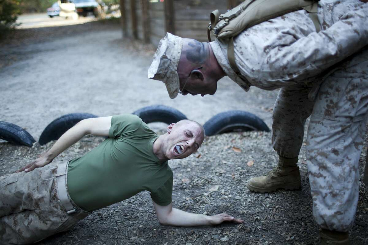 PARRIS ISLAND, SC - JANUARY 7: US Marine Corps Drill Instructors put recruits through upper body exercises called planks during the 54-hour Crucible event January 7, 2011 at the Marine Corps Recruit Depot on Parris Island, South Carolina. 359 recruits successfully completed the exercise. Marine boot camp is a 12-week training course and takes place at Parris Island, SC for recruits east of the Mississippi River and at Camp Pendleton, CA for those west of the Mississippi. The US Marine Corps includes just under 203,000 active duty Marines. (Photo by Robert Nickelsberg/Getty Images)
