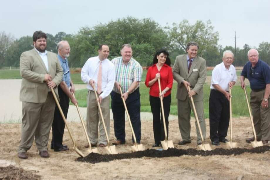 The first scoops of dirt are shoveled to make way for Falls at Green Meadows, during a groundbreaking ceremony held by the Katy Chamber of Commerce on April 17. Photo: Zach Haverkamp