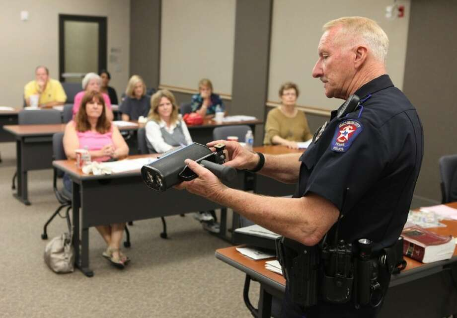 Missouri City Police Officer Gene Beeler talks about radar guns at the Citizens Police and Fire Academy class in Missouri City. (Photo by Alan Warren) Photo: Photo By Alan Warren