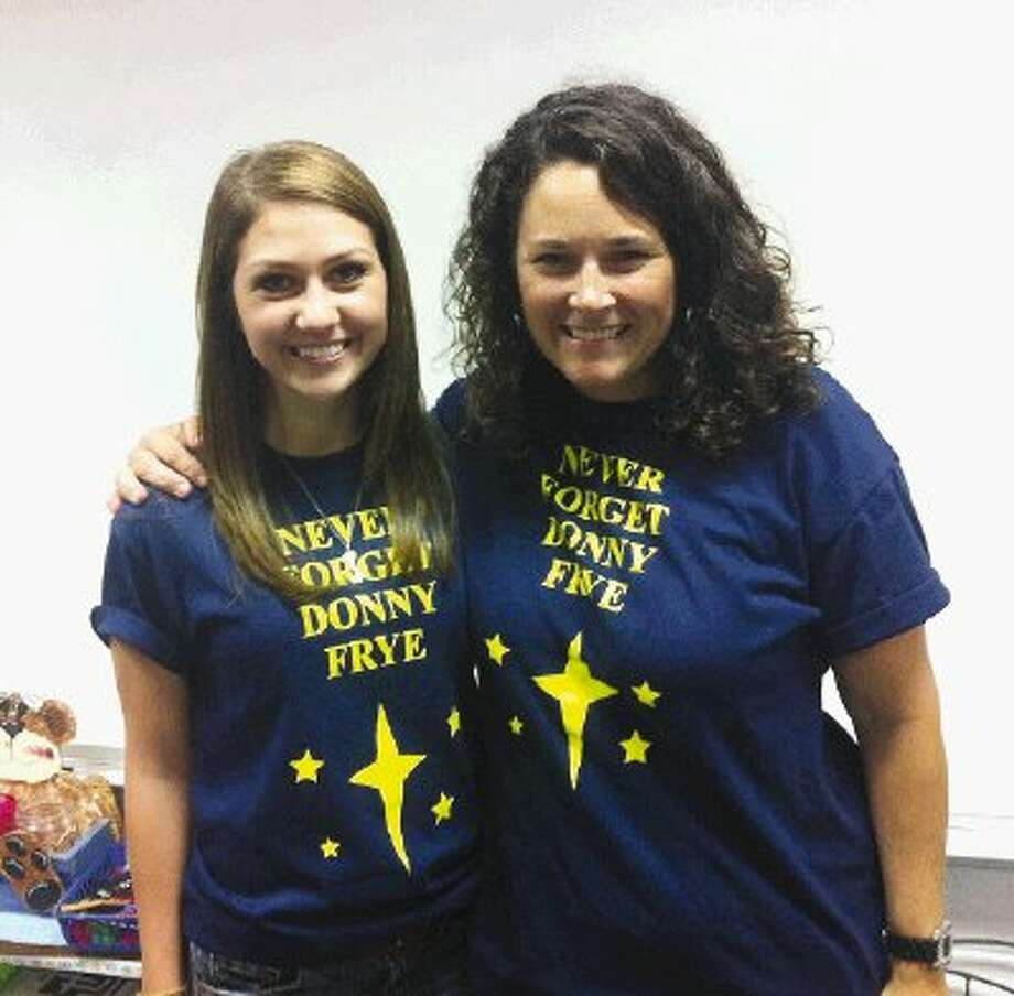 Emiley Sausley, left, and Liz Frye wear a T-shirt designed by Emiley.