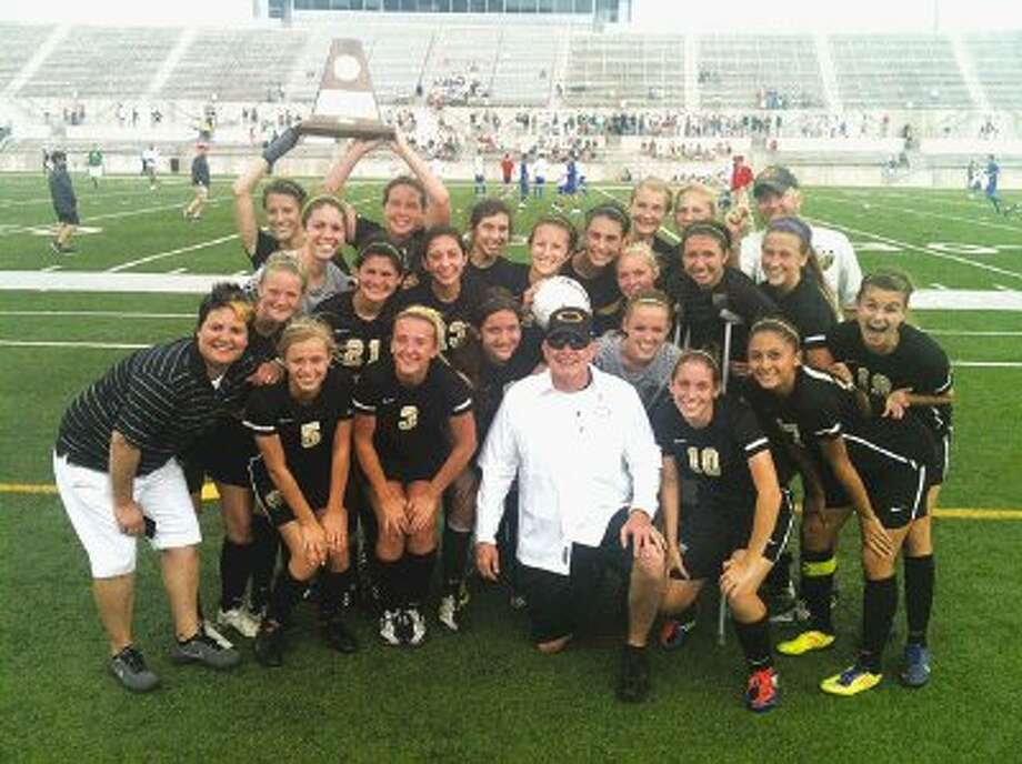 The Klein Oak girls soccer team shows off their Region II championship trophy after the Panthers defeated Garland Sasche 1-0 in double overtime Saturday afternoon to win the Region II championship in Round Rock and punch their ticket to the 5A state tournament, beginning Thursday in Georgetown. The Panthers, who are ranked in the top 50 nationally by ESPN, are now 25-1-1 on the season.