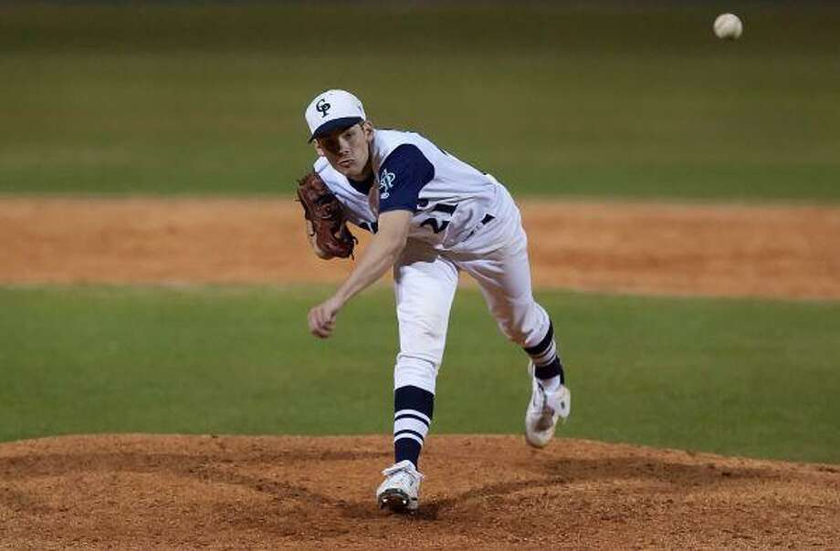 College Park's Austen Gunnels pitches during last week's Ferrell Classic game against Cinco Ranch. / The Courier