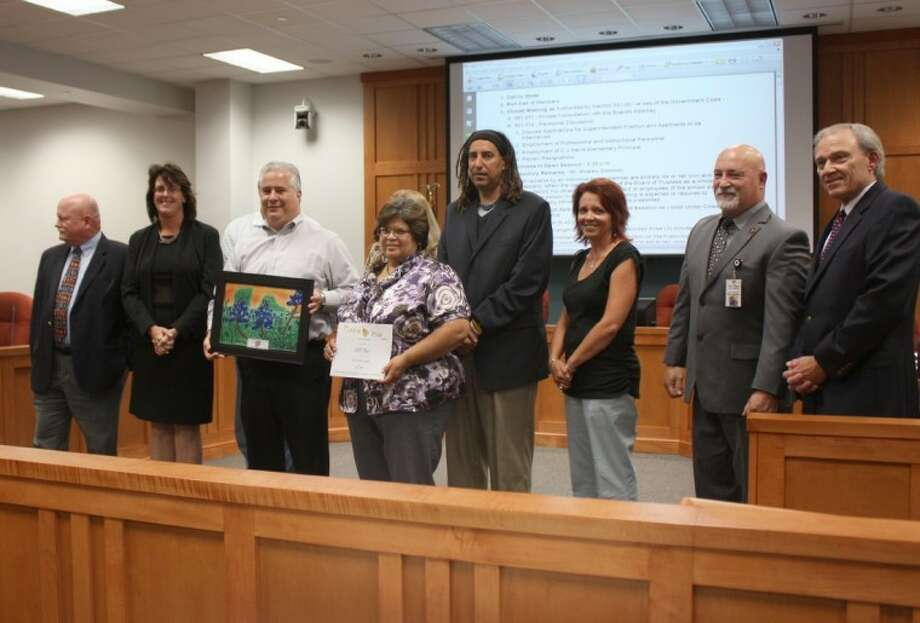 Pearland ISD Trustees recognized community partner H-E-B and presented awards to company officials Mike Cashiola and Anna Bryant at a recent school board meeting.