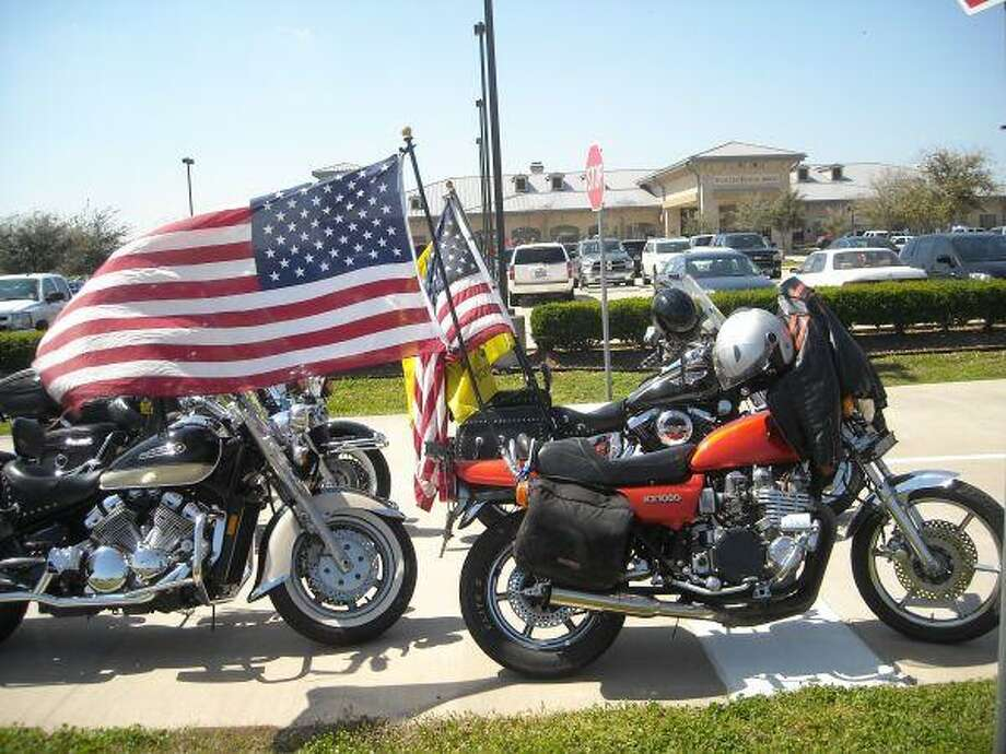 Motorcycles driven by members of the Patriot troops line the parking area outside of Sugar Land Airport.