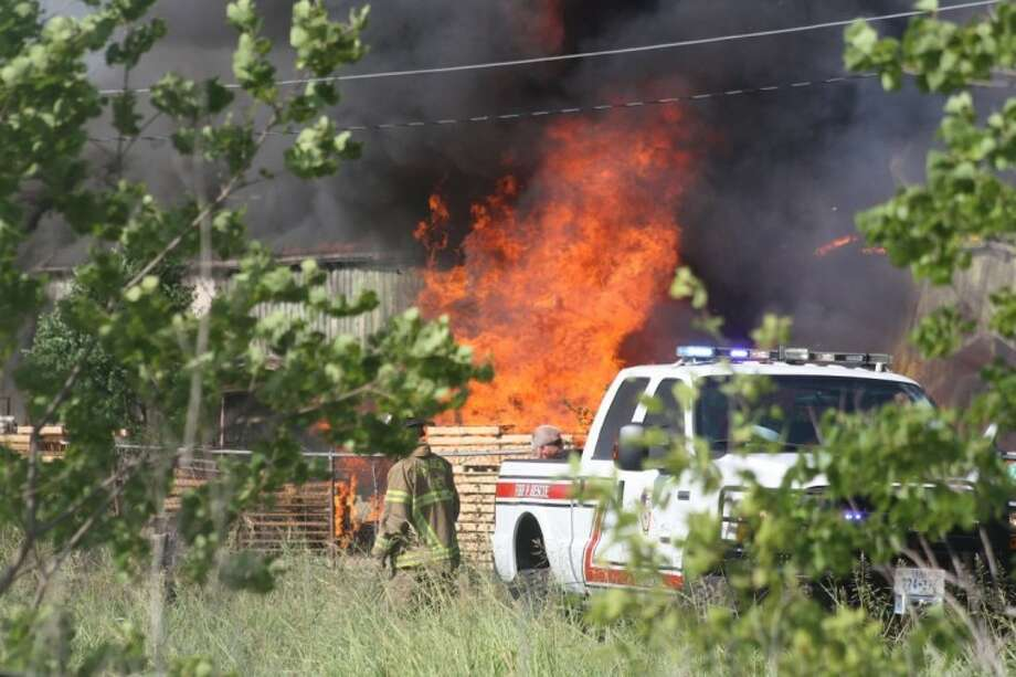 A large fire broke out just before 4:30 p.m. Sunday in the 6200 block of Spencer Highway near Space Center Boulevard at a warehouse which stored recycled plastic. Photo: Robert Avery