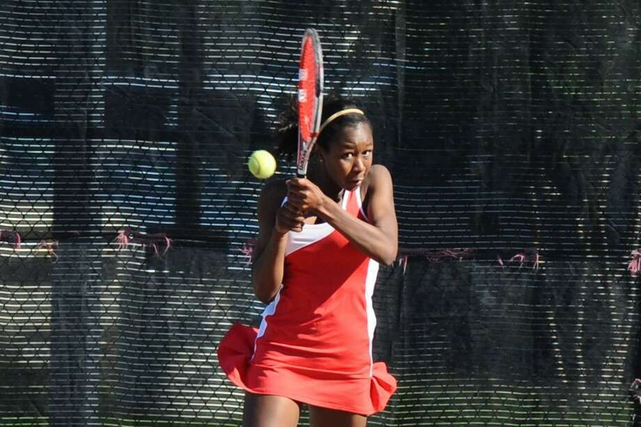 Dulles' Mariam Zein won the girls singles title at the Region III-5A tennis tournament this week in Deer Park. She lost five games in eight sets. (Photo by Kirk Sides) Photo: Kirk Sides