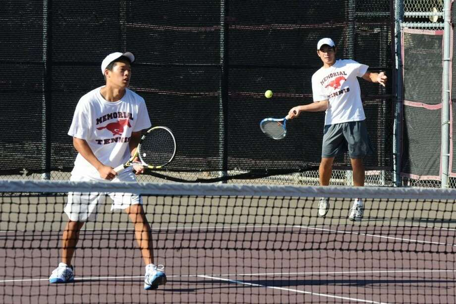 Memorial's Willie Jou and Grant Riechmann won the Region III-5A boys doubles championship Wednesday in Deer Park, advancing to the state tournament for the first time. Photo: Kirk Sides/HCN