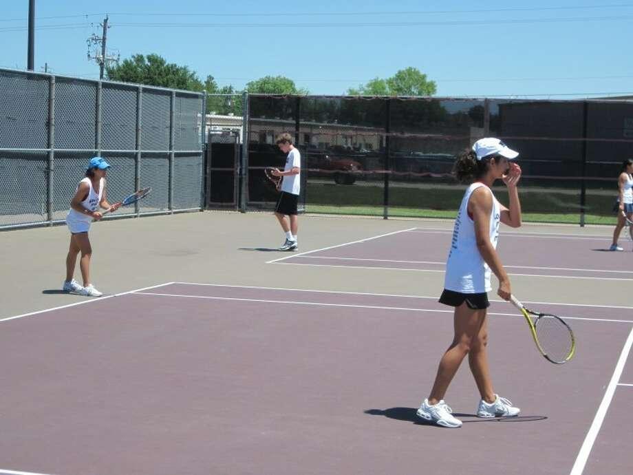 Memorial teammates Nava and Nousha Nowamooz won the Region III-5A girls doubles championship April 16-17 at Deer Park High School. Photo: Jack Marrion/HCN
