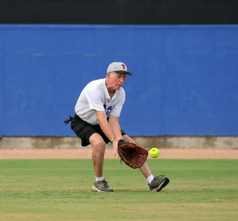William Cruse of Pasadena Gets for the Texas Classics gets ready to field a ball out in Left field during the National Senior Games softball tournament played in League City. Photo: Kar B Hlava