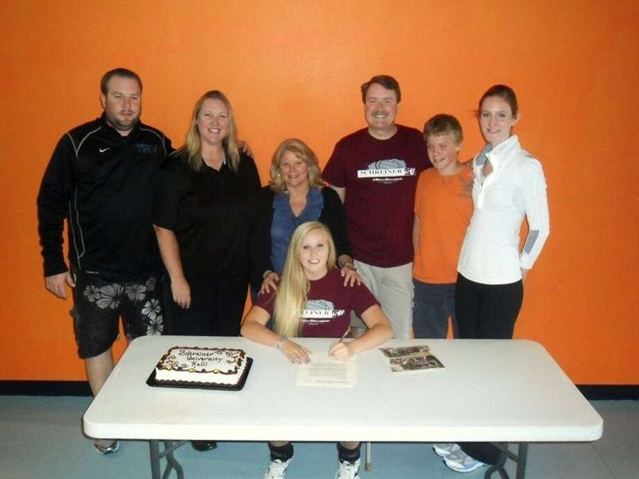 Kelli Bolen of Texas Revolution Volleyball Club and Clear Lake High School signs her commitment to play Volleyball at Schreiner University in Kerrville Texas. With her from left to right are TRV Director Christian Dunn, 18 Elite coach Sharon Nelson, parents Joan and Mark Bolen, brother Scott and 18 Elite coach Aly Hazelwood. Kelli was an All-District player 2009 and All-State Academic 2010. Photo: Courtesy Photo