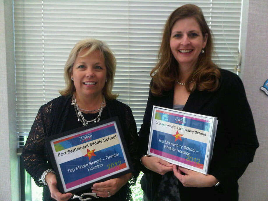 Pictured with Children at Risk certificates commending their schools' performance are (from left) Julie Diaz, principal at Fort Settlement Middle School; and Joanna Hagler, principal at Commonwealth Elementary School.