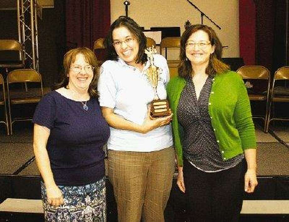The winning team in the 2010 Adult Spelling Bee, representing the Montgomery County Memorial Library System, was composed of, from left, Andrea Yang, Melissa Baker and Jessica Russell.