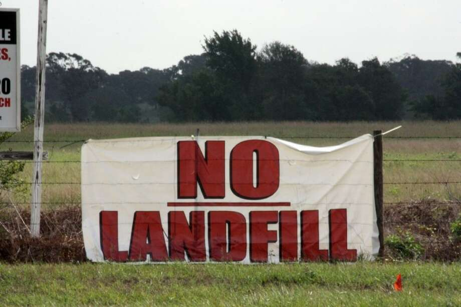 Even before Monday's official announcement of plans to build a landfill a mile north of Hempstead on Highway 6, a sign opposing the plan was hung on a fence near the proposed site.