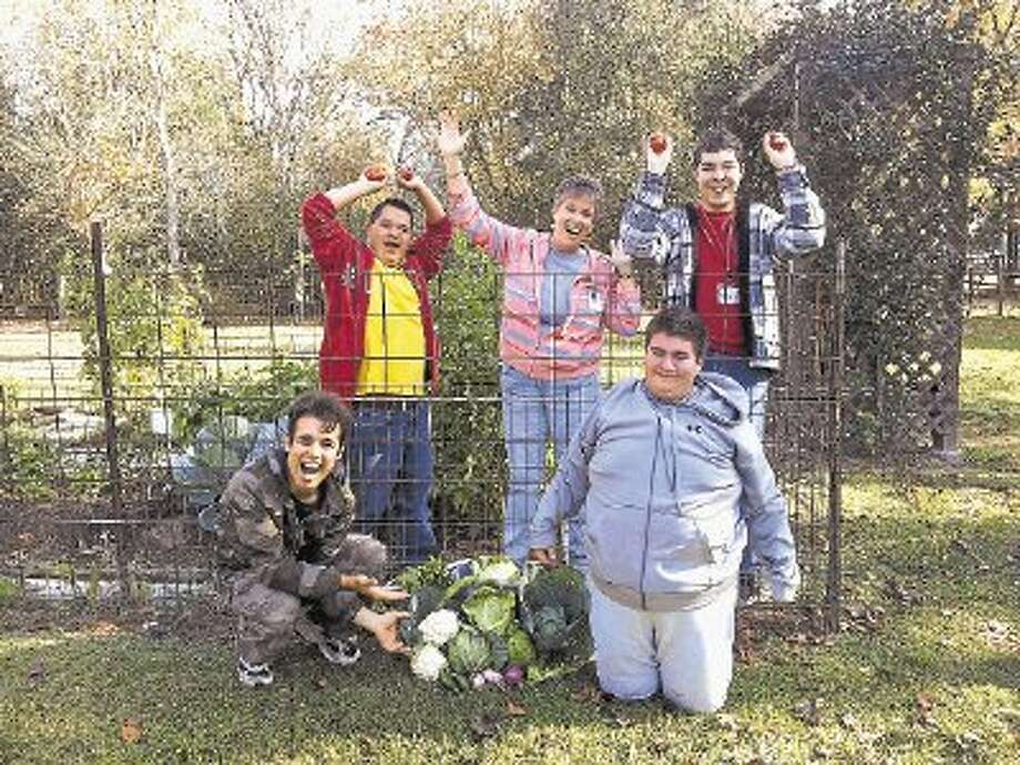 Work Based Learning program students enjoying the fruits (or rather vegetables) of their labor. From left to right: Sam Gorski, Richard Avila, Employability Skills Instructor/Para-professional Mary Maltz, Jared Mesker and Caleb Fraiser. Photo: Submitted / @WireImgId=2623249