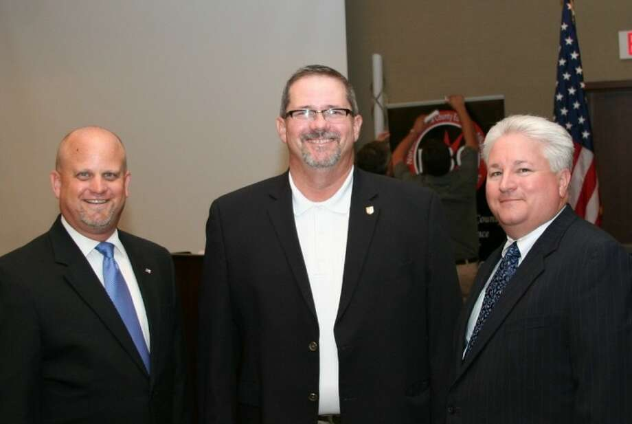 Kevin Cole visits with Brazoria County Commissioners Matt Sebesta and Stacy Adams at the CEO Roundtable Luncheon. Photo: Courtesy NBCEA