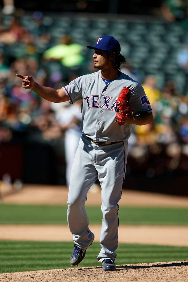 OAKLAND, CA - SEPTEMBER 24:  Yu Darvish #11 of the Texas Rangers celebrates after striking out Yonder Alonso (not pictured) of the Oakland Athletics during the seventh inning at the Oakland Coliseum on September 24, 2016 in Oakland, California. The Texas Rangers defeated the Oakland Athletics 5-0. (Photo by Jason O. Watson/Getty Images) Photo: Jason O. Watson/Getty Images