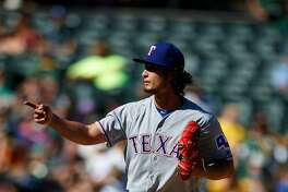 OAKLAND, CA - SEPTEMBER 24:  Yu Darvish #11 of the Texas Rangers celebrates after striking out Yonder Alonso (not pictured) of the Oakland Athletics during the seventh inning at the Oakland Coliseum on September 24, 2016 in Oakland, California. The Texas Rangers defeated the Oakland Athletics 5-0. (Photo by Jason O. Watson/Getty Images)