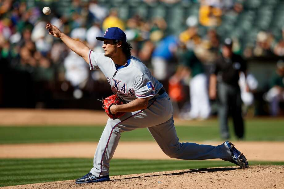 OAKLAND, CA - SEPTEMBER 24:  Yu Darvish #11 of the Texas Rangers pitches against the Oakland Athletics during the seventh inning at the Oakland Coliseum on September 24, 2016 in Oakland, California. The Texas Rangers defeated the Oakland Athletics 5-0. (Photo by Jason O. Watson/Getty Images) Photo: Jason O. Watson/Getty Images