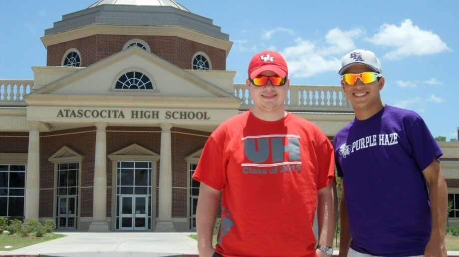 Christian Forbes (left) and Forrest Cox each received full-ride scholarships after serving as managers for Atascocita's football team. Photo: Stephen Whitfield