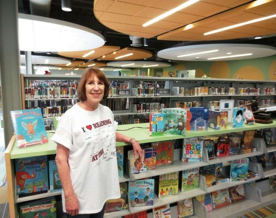 """For a donation of $10, $12 for XXL, to HCFOL, readers will receive an """"I Love Reading…at the Harris County Public Library"""" tee-shirt with the signatures of over 50 mystery authors. There are tee-shirts with over 30 popular authors' signatures."""