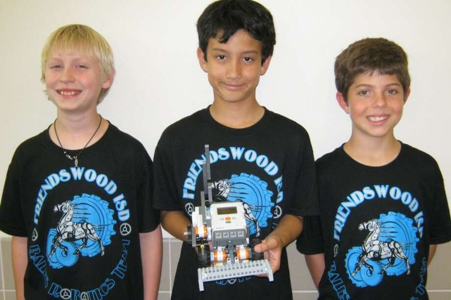 Westwood-Bales students on the Boss Robots Team, Austin Cloyd (4th grader), Lucas Hopkins (5th grader), and Colin Madden (5th grader) were recently chosen as a wildcard team to participate in the Texas Computer Education Association Robotics Contest. Photo: Courtesy Friendswood ISD