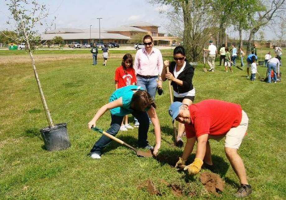 """All of the Northwoods Catholic School's eighth graders planted a tree and marked each one with a brick with their name and """"Class of 2010"""" on it."""
