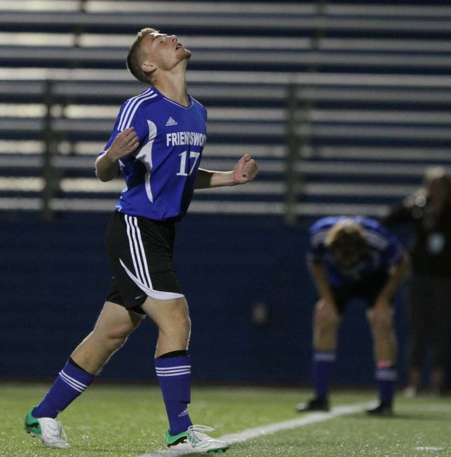 Friendswood midfielder Sean Byron (17) and midfielder Jose Montalvo (23) react after Byron missed a shot in the second period of the boys soccer Class 4A semifinals game at Birkelbach Field on April 20, in Georgetown. San Antonio Alamo Heights defeated Friendswood 1-0. Photo: Jason Fochtman
