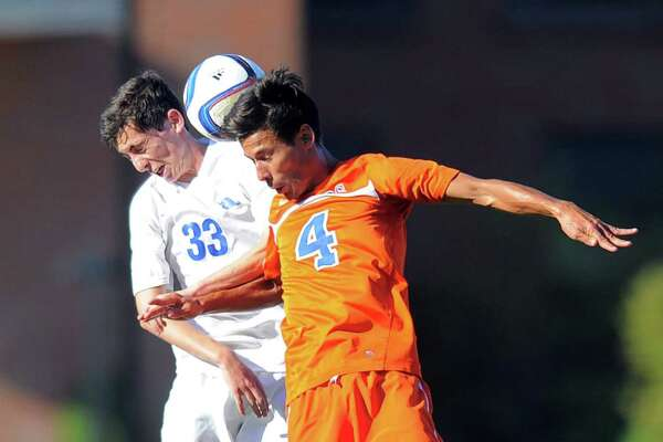 Darien's Ari singer-Freeman, left, and Danbury's Felipe Dos Reis fight for the ball during their boys soccer game Wednesday at Darien High School. Danbury won 2-0.