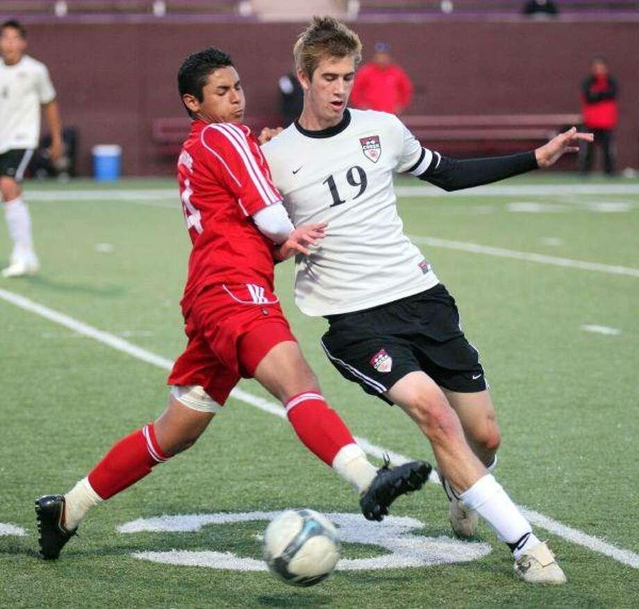 Clear Creek midfielder Steven McRaith wants to control the ball against North Shore. — Photo by Kar Hlava