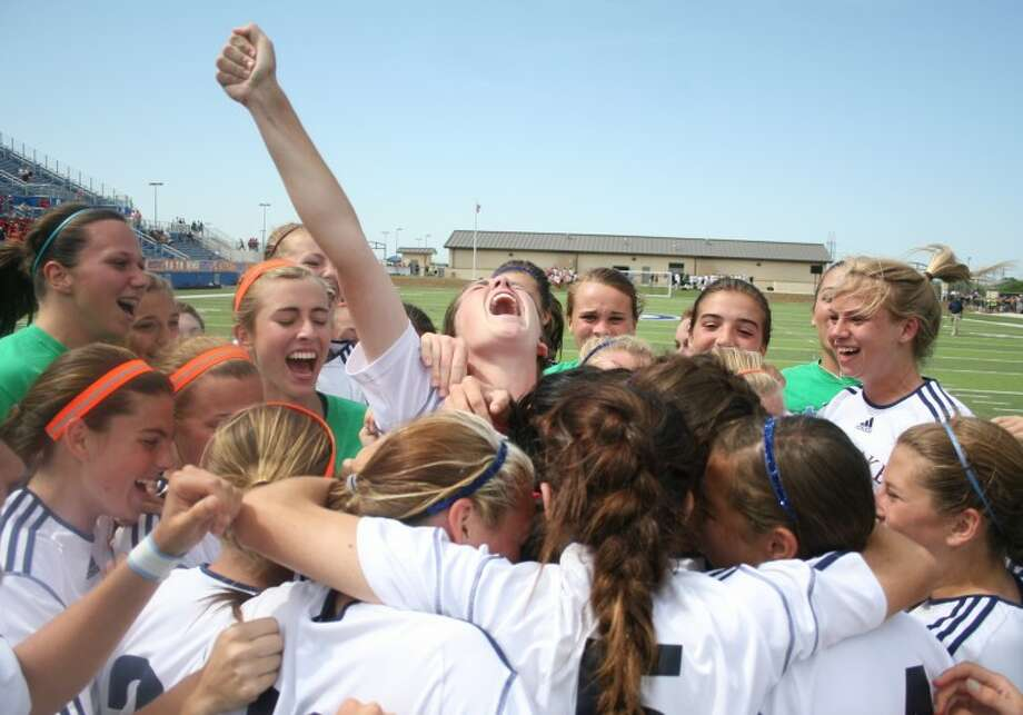 Seven Lakes celebrates after defeated San Antonio Churchill 3-2 in penalty kicks during the girls soccer 5A semifinals match against San Antonio Churchill at Birkelbach Field on April 19, in Georgetown. Photo: Jason Fochtman